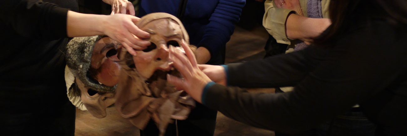 photo: hands touching masks at the Don Quixote Touch Tour (Rick Waines)
